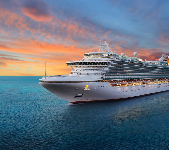 large cruise ship out at sea during the sunset